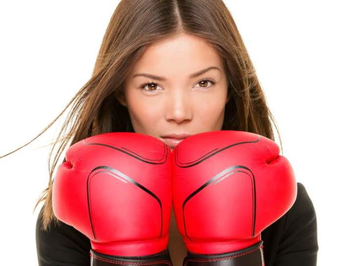 Businesswoman boxing gloves