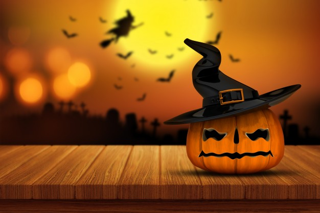 halloween-pumpkin-on-a-wooden-table_1048-3118