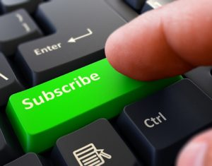 Subscribe - Concept on Green Keyboard Button.