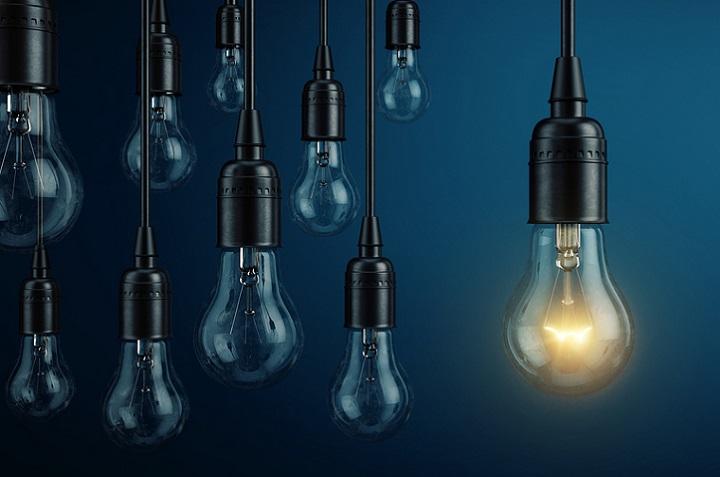 Unique, leadership, new idea concept - One light bulb lamp glowi
