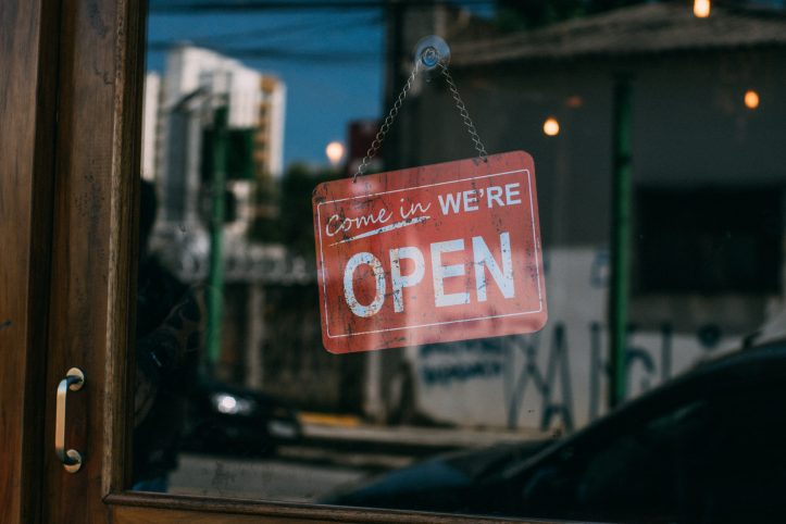 Canva-Open-Signage-Hanging-on-Glass-Door-of-Vicinity-scaled